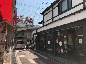 A traditional looking Japanese building with a small shop