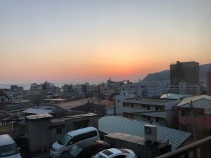 Sun rising over the ocean from the small town of Ito Japan
